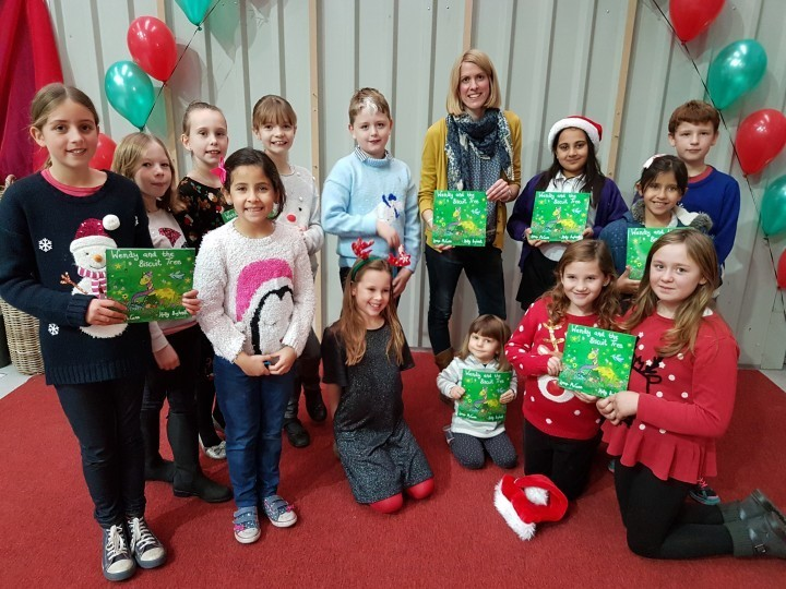 Author Lorna McCann from Newport with children from St Mary's Primary School in Shawbury.