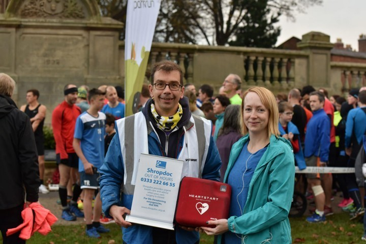 Paul Bowes, Event Director of Shrewsbury parkrun receives the defibrillator from Emma Feely, of Shropdoc.  Photograph by Colin Williamson