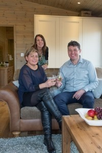 Jane Edmunds from Alan Ward with Ashlea Pools Country Park owners Lee and Leigh Burdon.