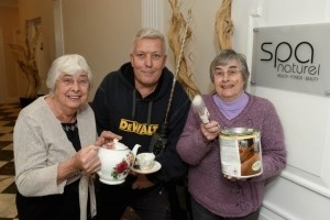 Sisters Margaret Roberts and Christine Smith offer to help make tea for hotel site manager Paul Harding and his team as work begins on the leisure club revamp.
