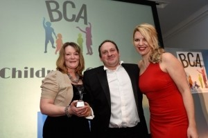 Sally and Stephen Johnson collect the award for the 2016 BCA Children's Charity from Steff Parker, representing Beaumont Lawrence.