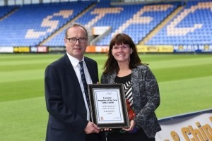 Kirsty Smallman receives the Support to Caradoc award from business manager Peter Masters.