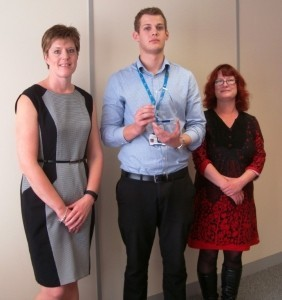 Director of HR Debbie Morris, Sebastian Littlefair-Vernon with his Unsung Hero award and Emma Dowler, fundraiser for the West Midlands branch of the Alzheimer's Society.