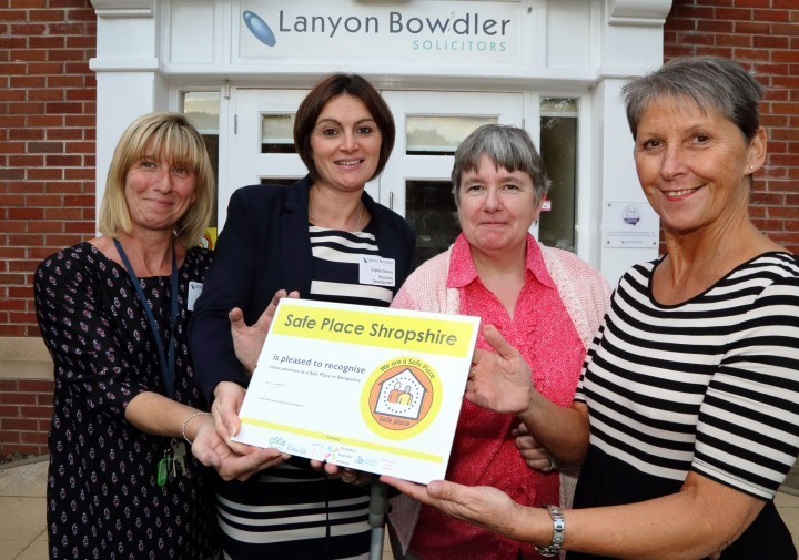 Paula Griffiths, Sophie Davies, Ruby Hartshorn and Ann Shaw with the Safe Places sign at Lanyon Bowdler's Shrewsbury office.