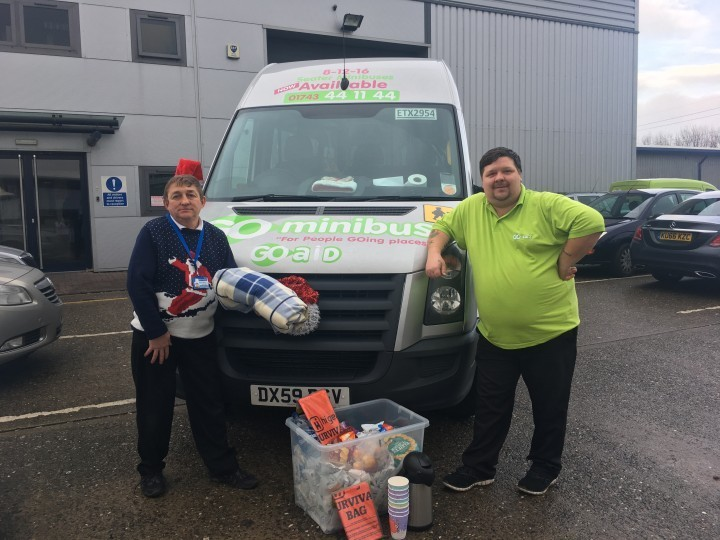 Taxi drivers donating food and blankets to the homeless