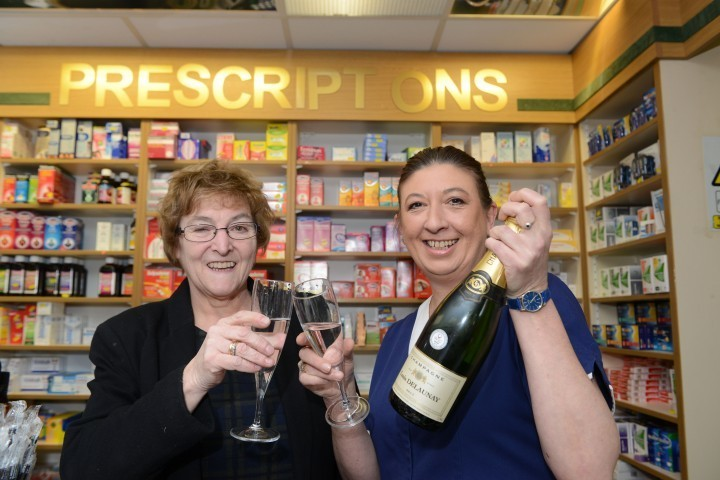 Staff at a Shropshire pharmacy celebrate 55 years service