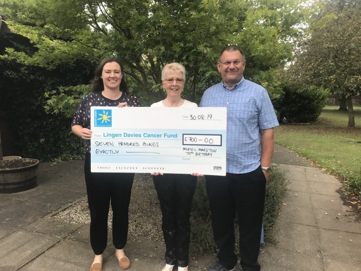 Oswestry couple hand over birthday donations to Lingen Davies to say thank you for treatment