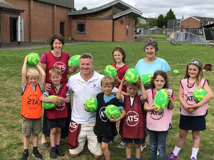 Ex-England rugby star helps Shropshire children improve their skills at charity summer club
